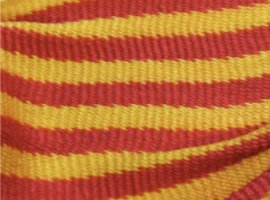 The identifying characteristic in sprang sashes that are striped is found along the line where two colors meet. The line should be jagged as the threads wrap around their neighbor...
