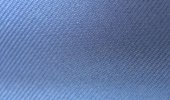 Gabardine has long diagonal lines and is a tough, tightly woven fabric out of any fibre (wool, cotton, synthetics)