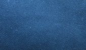 Denim is defined by material and dye, though nowadays elastic and synthetic fibres are introduced and other colours than indigo-blue for the weft appear as well